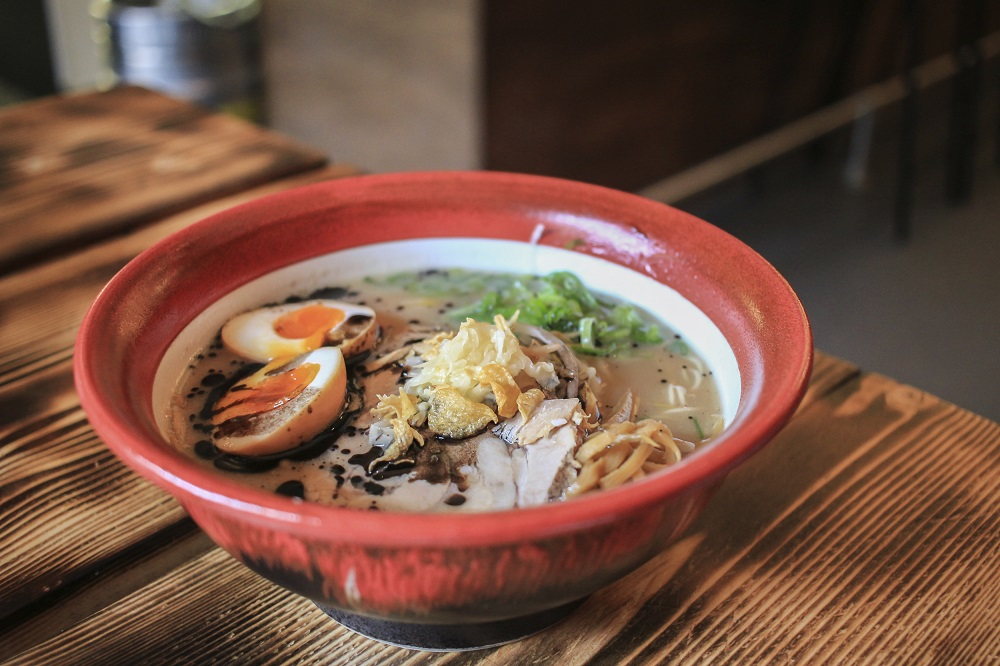 Bowl of ramen on a wooden table.