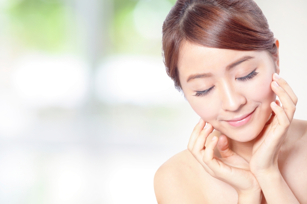"""""""close up of Beauty woman Face and hand touch her face with green background for skin care concept, model is a beautiful asian girlFace Beauty"""""""